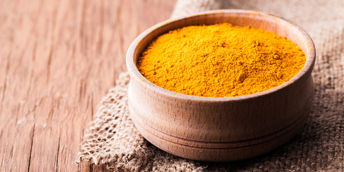 Bowl of turmeric powder