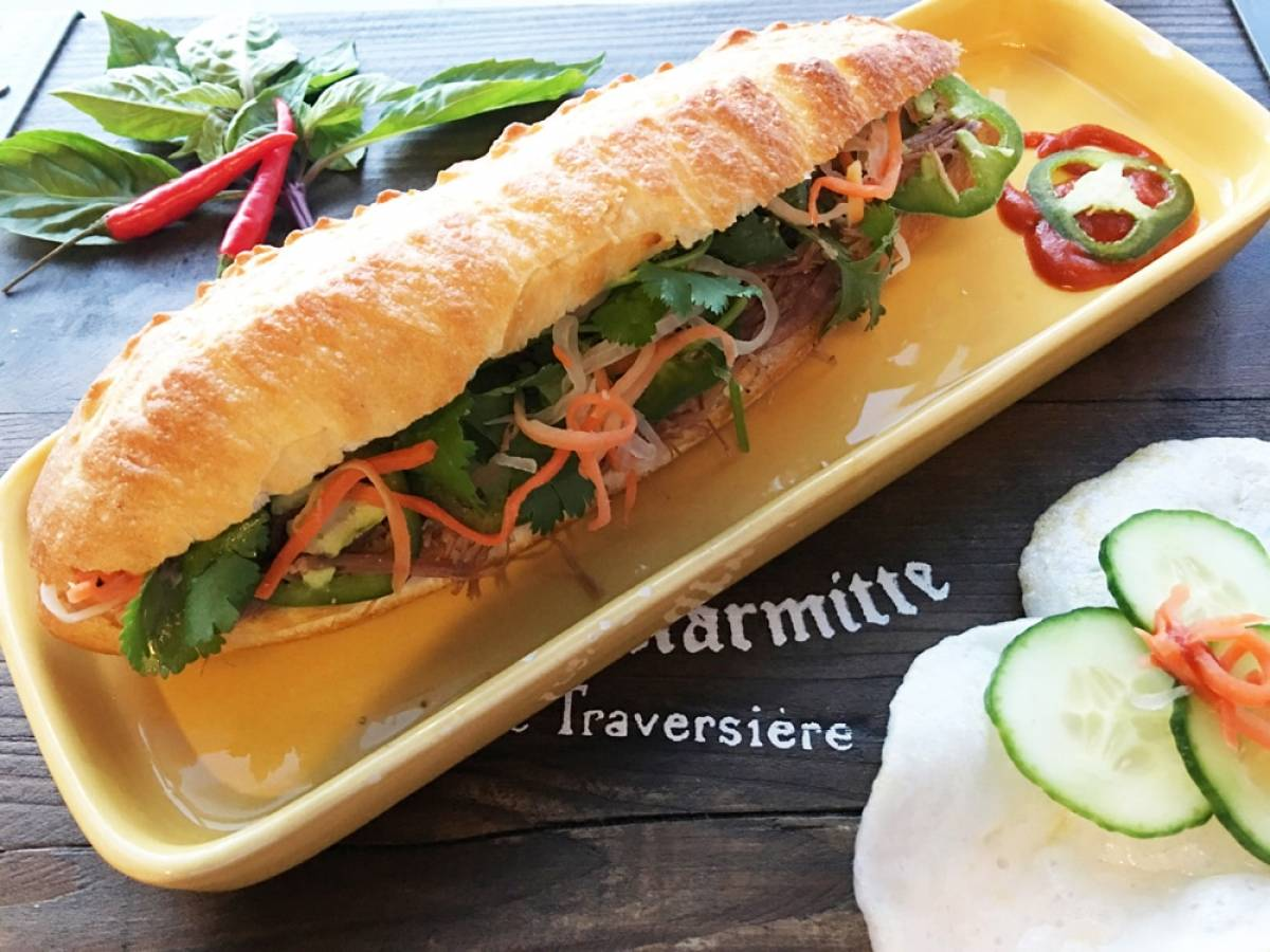 A bánh mì (a Vietnamese baguette made with various ingredients).