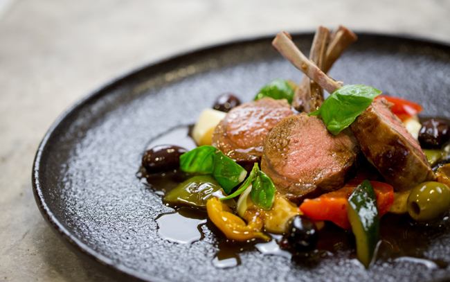 Roasted rack of English Lamb with chargrilled Provençal vegetables, basil and anchovy jus