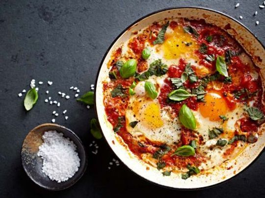 Shakshuka, an Israeli/Tunisian breakfast staple of eggs poached on a spiced tomato and pepper sauce, is gaining popularity in the U.S.