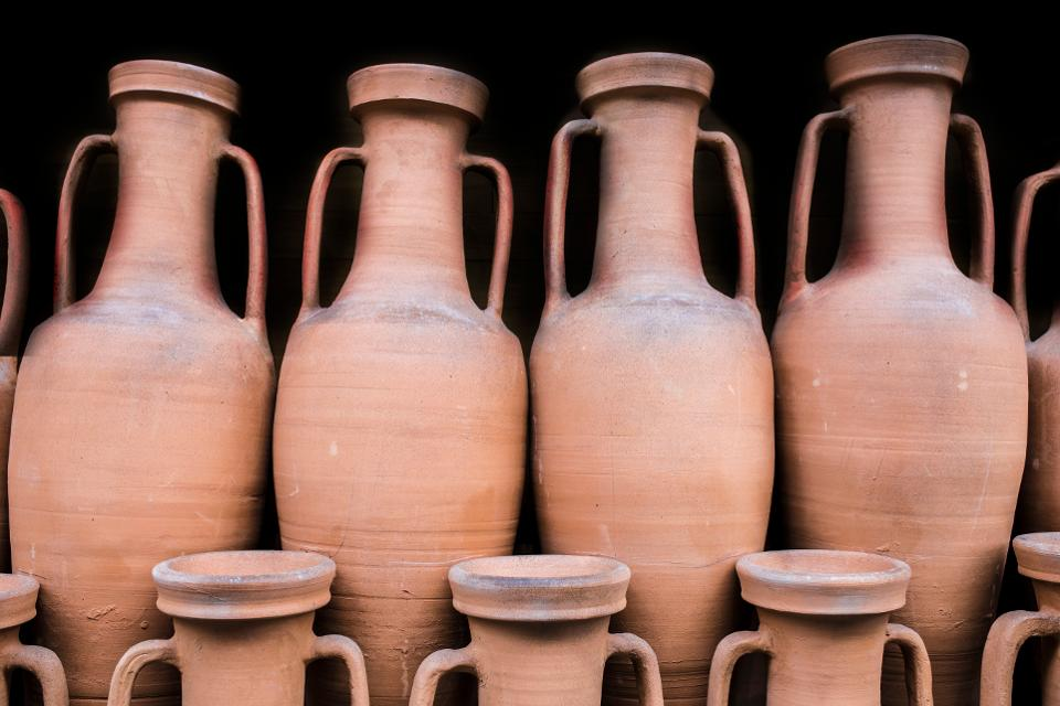 Ancient roman amphorae stored at hold ship as ancient times trade