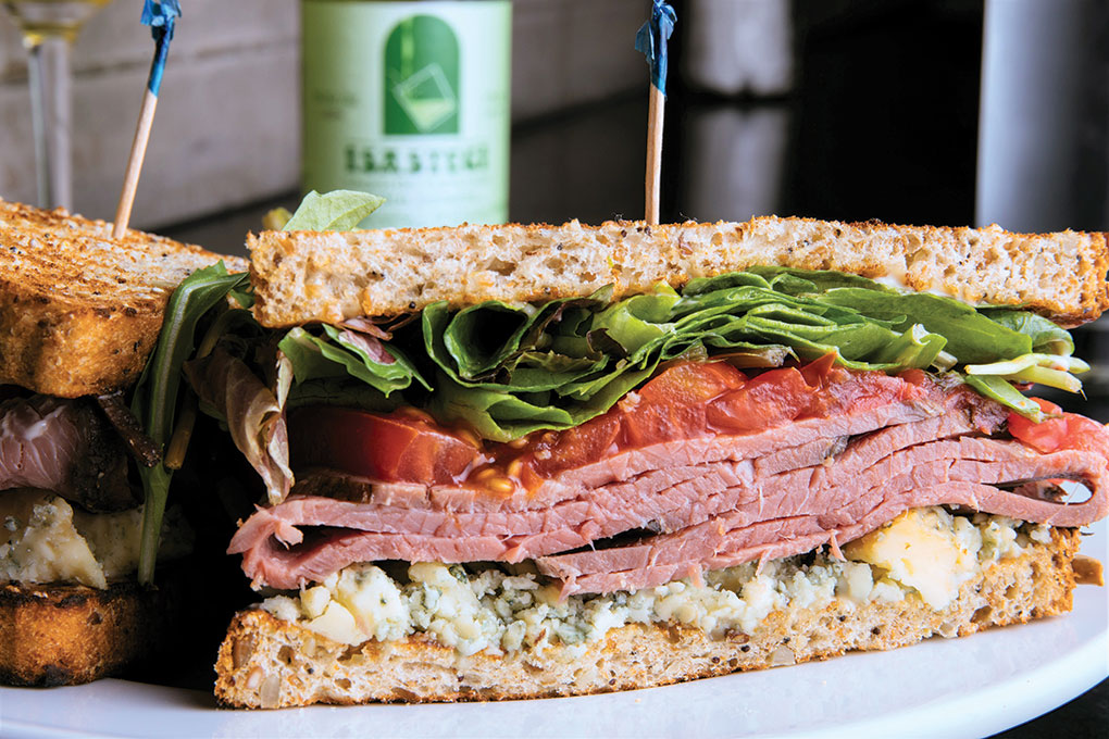 At St. James Cheese Company, a New Orleans cheese shop/restaurant, Mycella blue cheese gets smoked in house to make its signature funk even more flavorful when included on a savory roast beef sandwich build.
