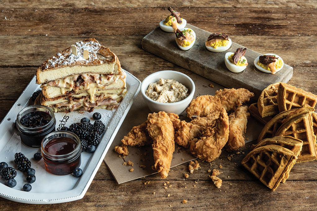 """Just Add Bubbles"" featuring Deviled Eggs topped with short rib; Chicken & Waffles with maple syrup and housemade sausage gravy; and French Toast Monte Cristo filled with pit ham and white cheese sauce, served with a sweet-tart seasonal jam and fresh berries."