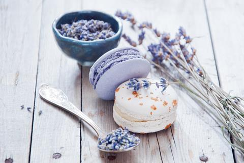 Lavender macarons next to pieces of lavender