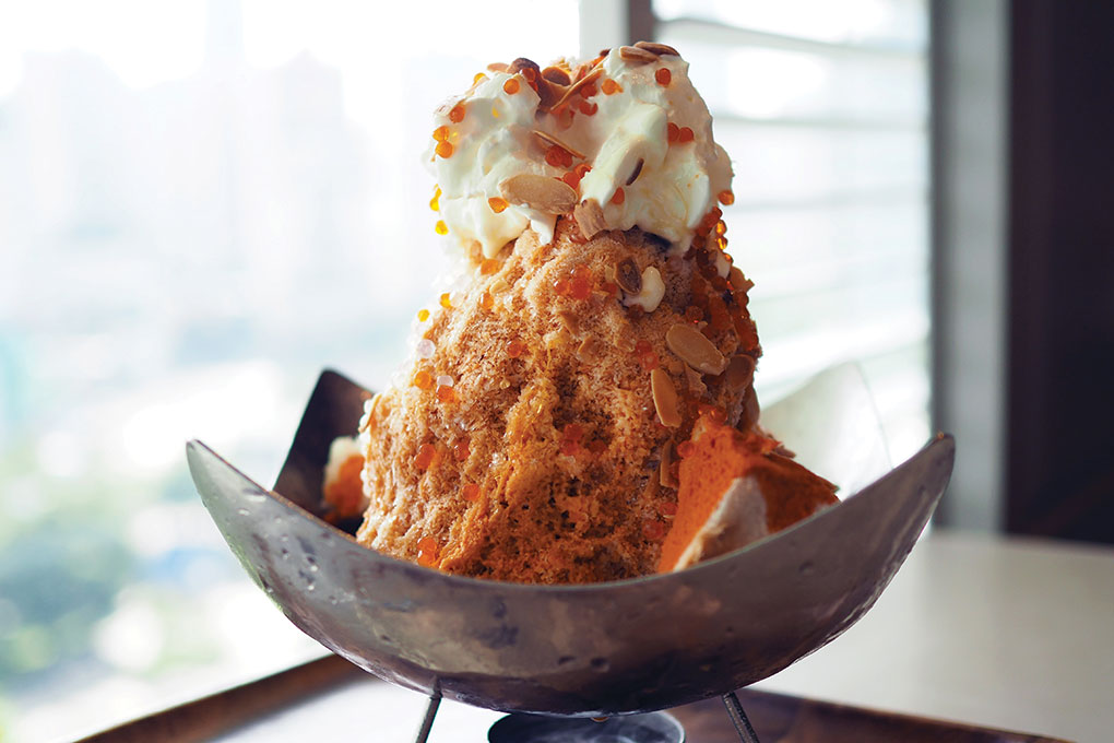 The flavors of Thai tea get transformed into a showstopping Thai Tea Shaved Ice, served with a scattering of tamarind boba and toasted almonds over whipped cream.